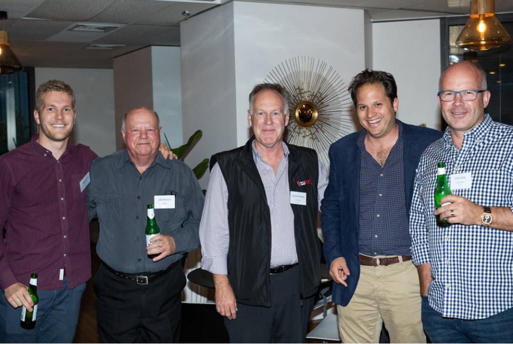 Five men smiling on camera