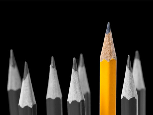 Eight pencils on dark background
