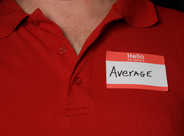 AS - a man wearing an average sticker on his shirt