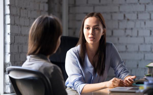 Professional female advisor consulting client