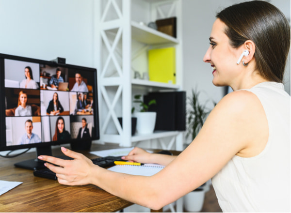 Woman is using app on pc for connection with colleagues