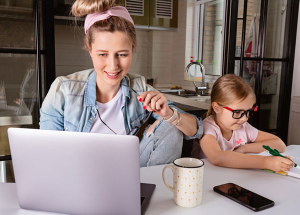 Business Woman using laptop on kitchen