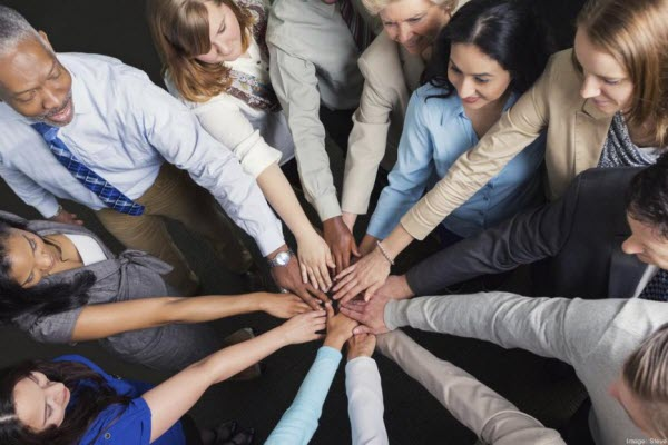Diverse Business Team with hands in huddle