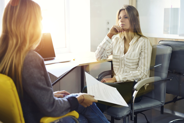 Woman listening to her colleague while at the office