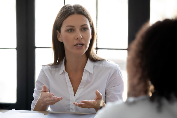 Businesswoman talking with business partner in office