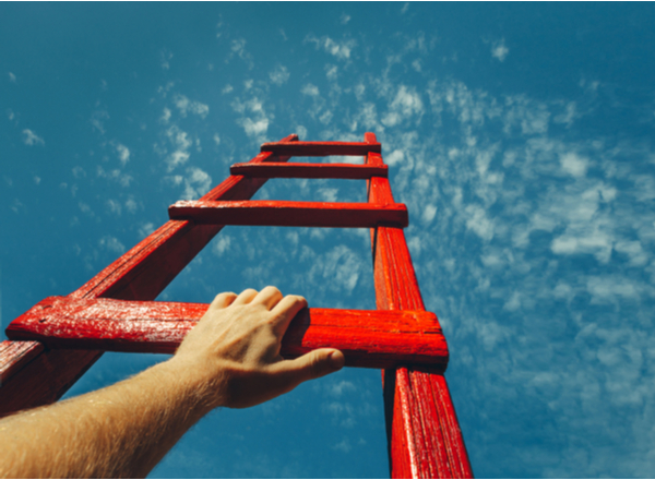 AS - Mans Hand Reaching For Red Ladder