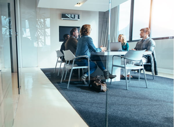 Group of business people having discussion in conference room